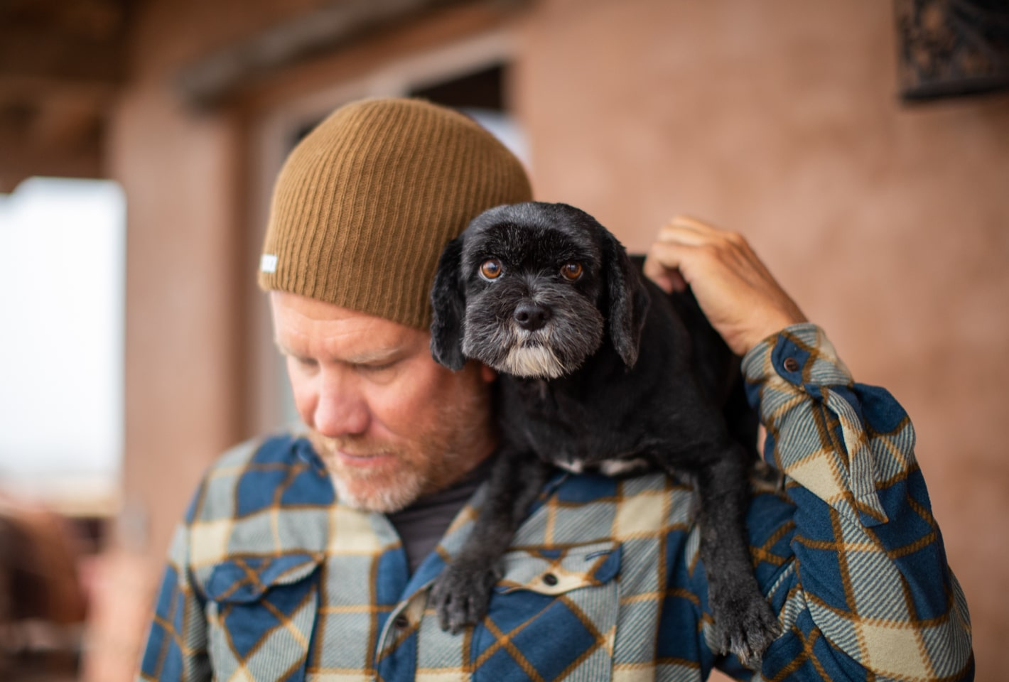 Ron with Chevy the dog sitting on his shoulder