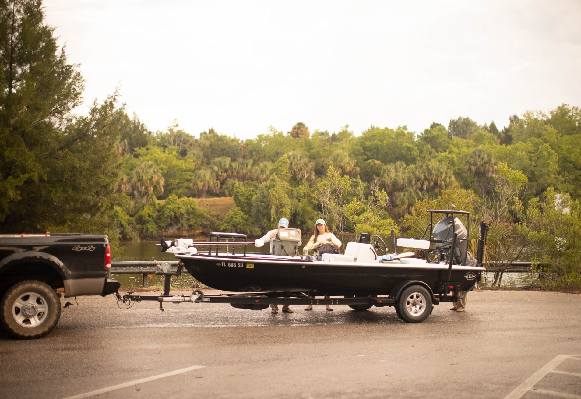team loading up skiff before fishing