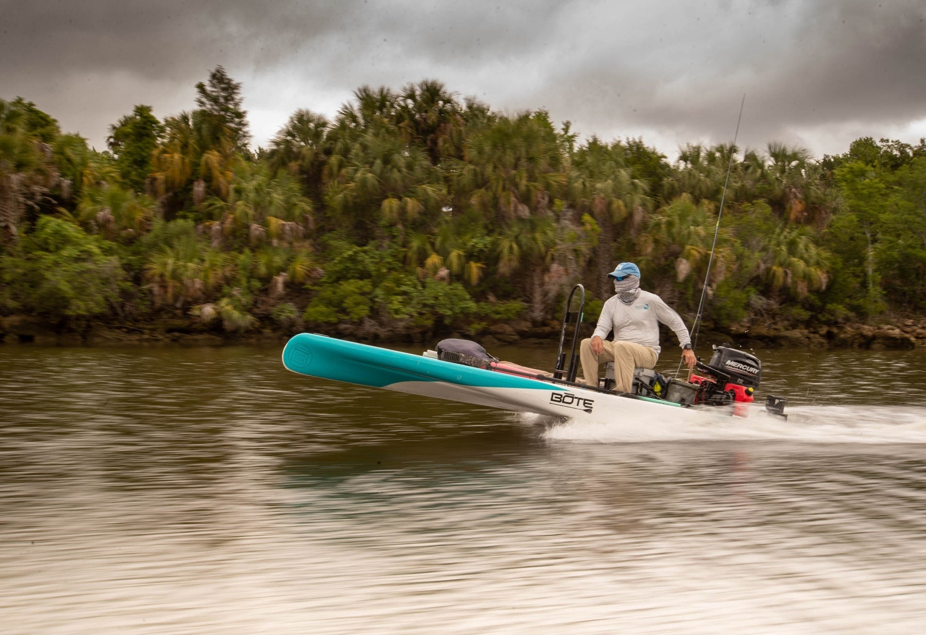 man driving BOTE mircoskiff the rover in florida
