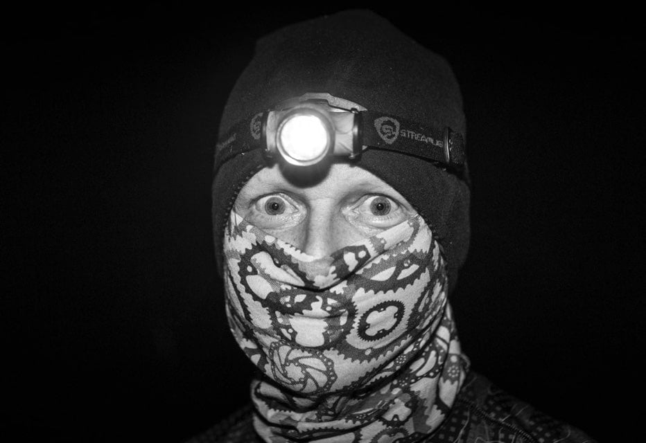 man wearing headlamp and neck gator