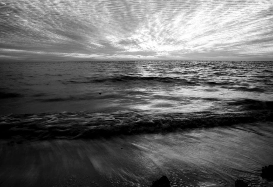 black and white beach horizon line