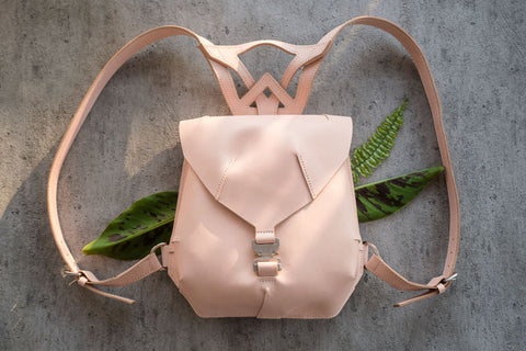 veg-tan leather backpack