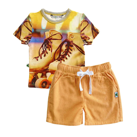 T-shirt printed with an image of a pair of retro style roller skates paired with matching shorts