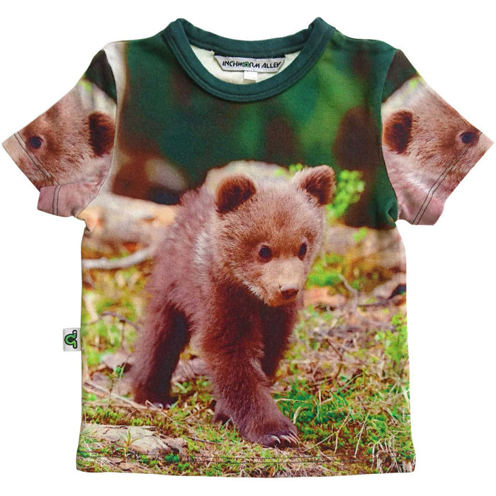 T-shirt printed with an image of an adorable brown bear cub walking around outdoors