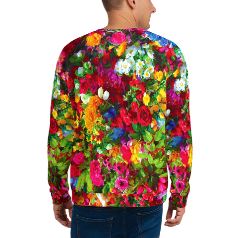 Man wearing a sweatshirt with an all-over print of multicoloured flowers and the word FEMINIST across the front body