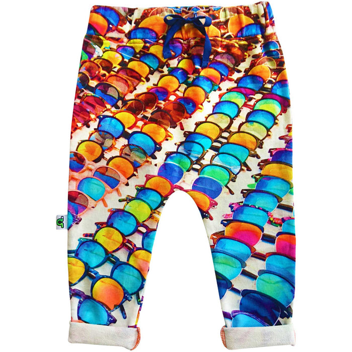 Sweatpants with print of rows upon rows of multicolor sunglasses