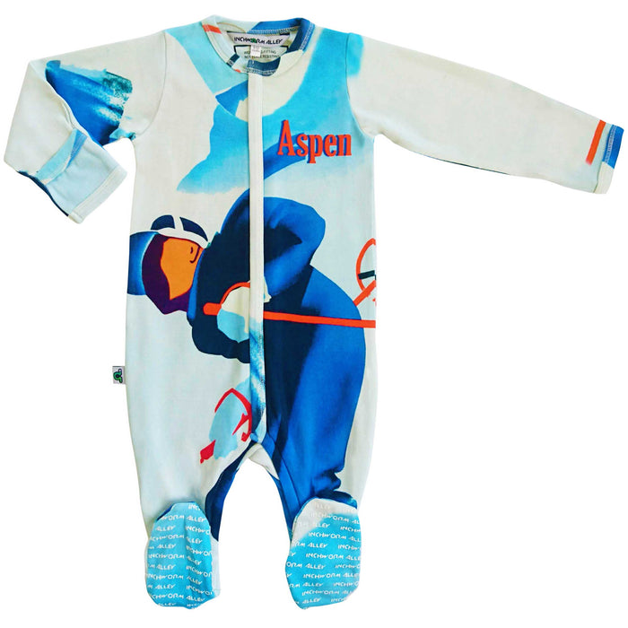 "Full sleeve footie onesie printed with a stylized skier and the text ""Aspen"""