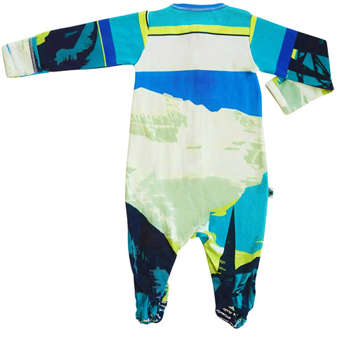 Full sleeve footie onesie printed with vintage tourism poster promoting Lake Louise and the Canadian Rockies with an illustrated mountain landscape