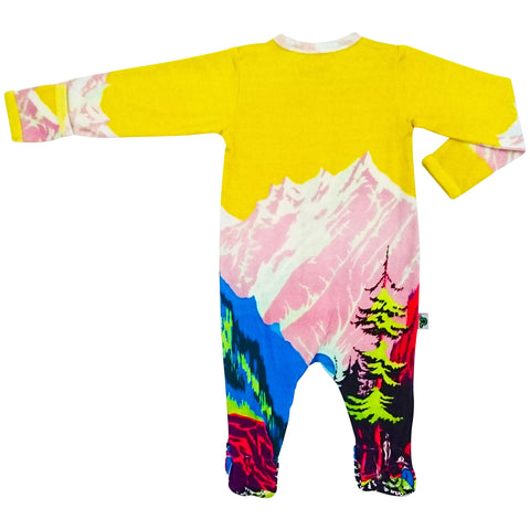 Long sleeve footie with print of vintage travel poster depicting a mountain valley with trees and hikers