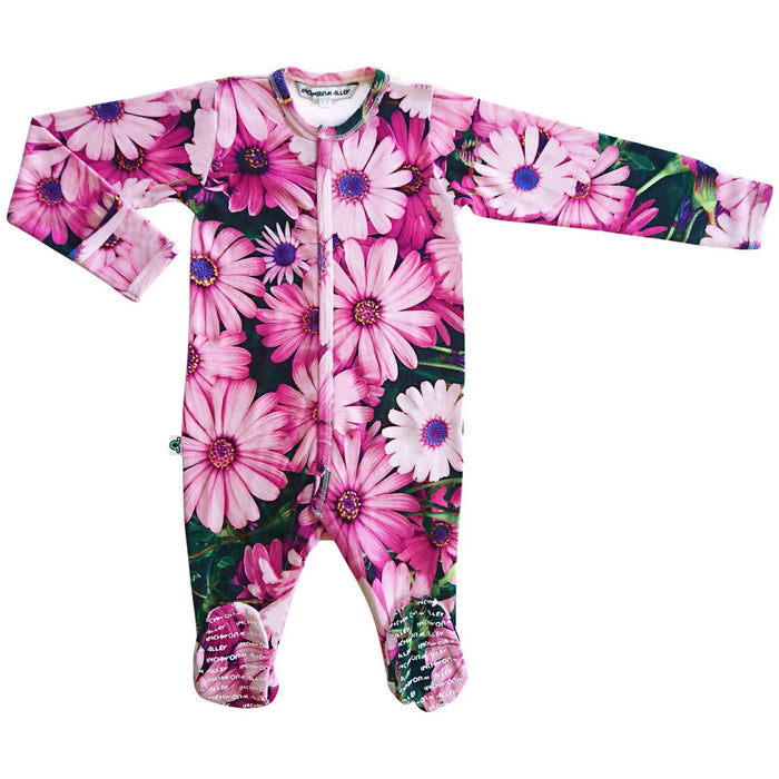 Long sleeve footie with an all-over print of a brightly coloured pink daisies