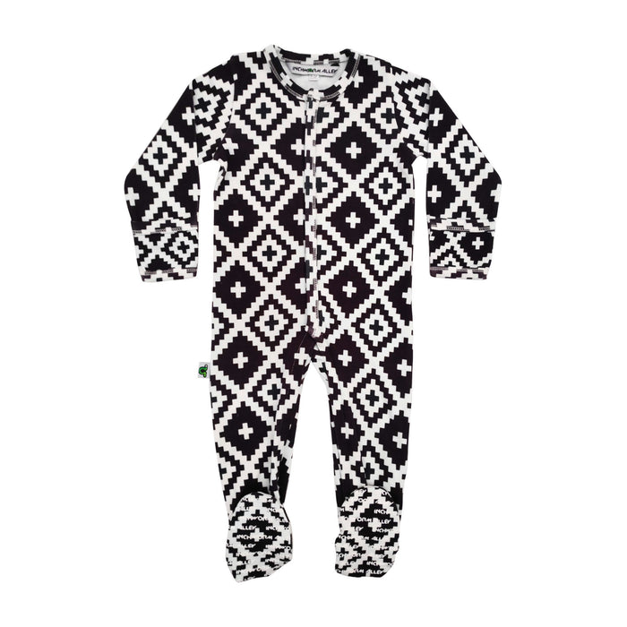 Long sleeve footie with an all-over print design of black and white squares and diamonds in geometric formation