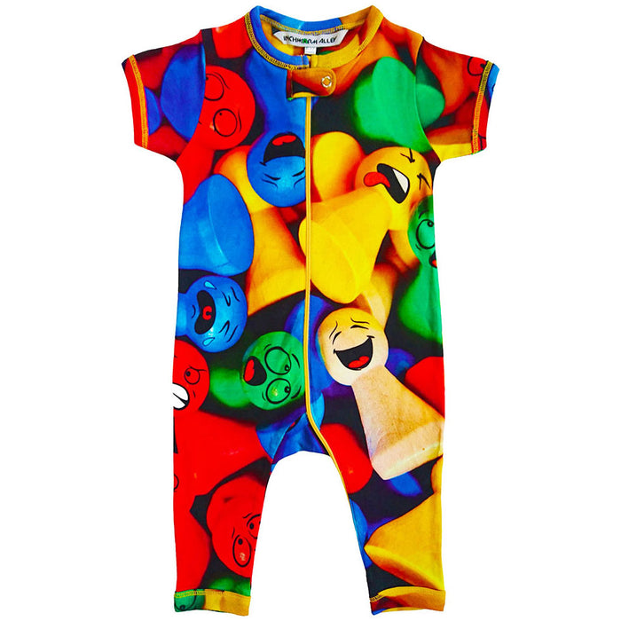 Front view of short sleeve, full leg romper with all-over print of multicoloured game pieces