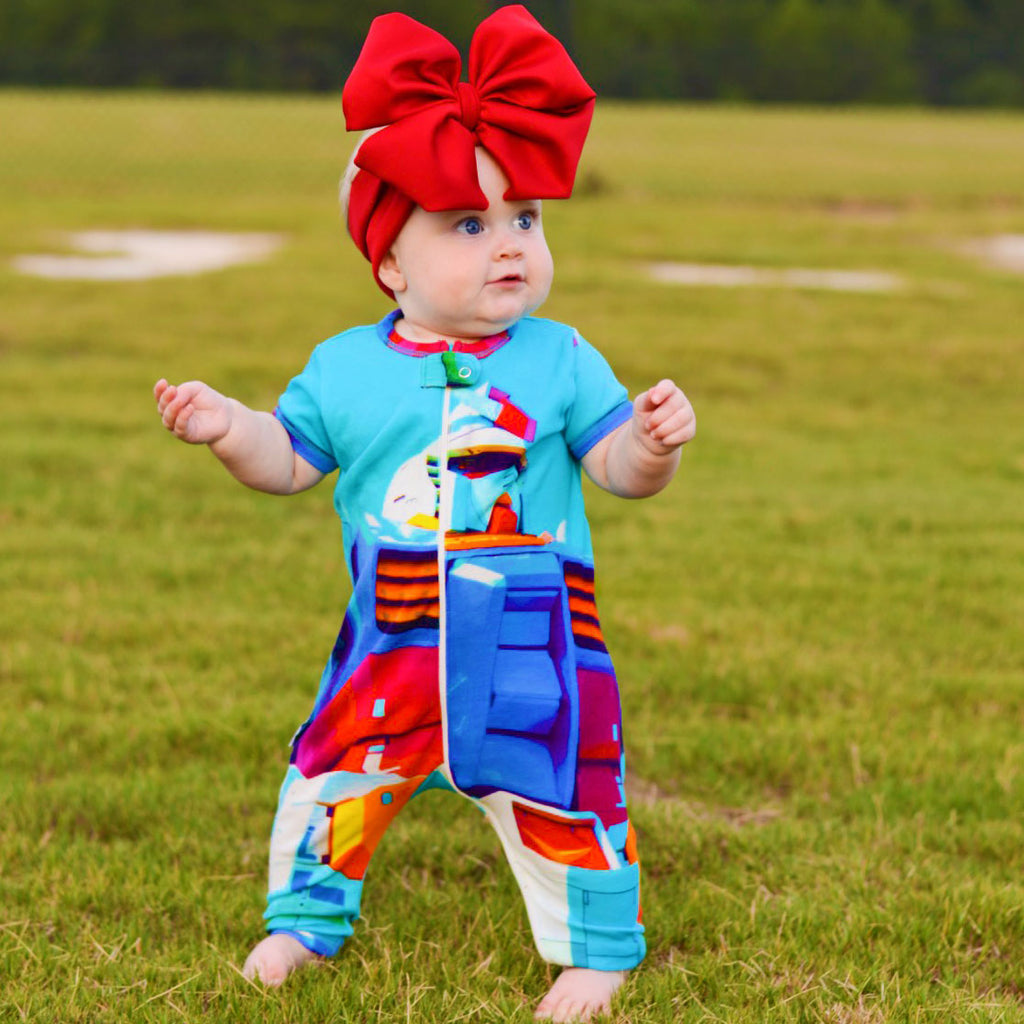 Baby wearing a short sleeve, full leg romper printed with a life-size Japanese robot
