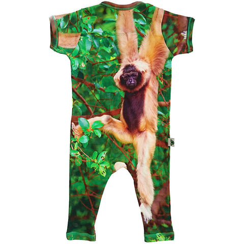 Back view of short sleeve romper with full legs printed wih a monkey hanging from a tree