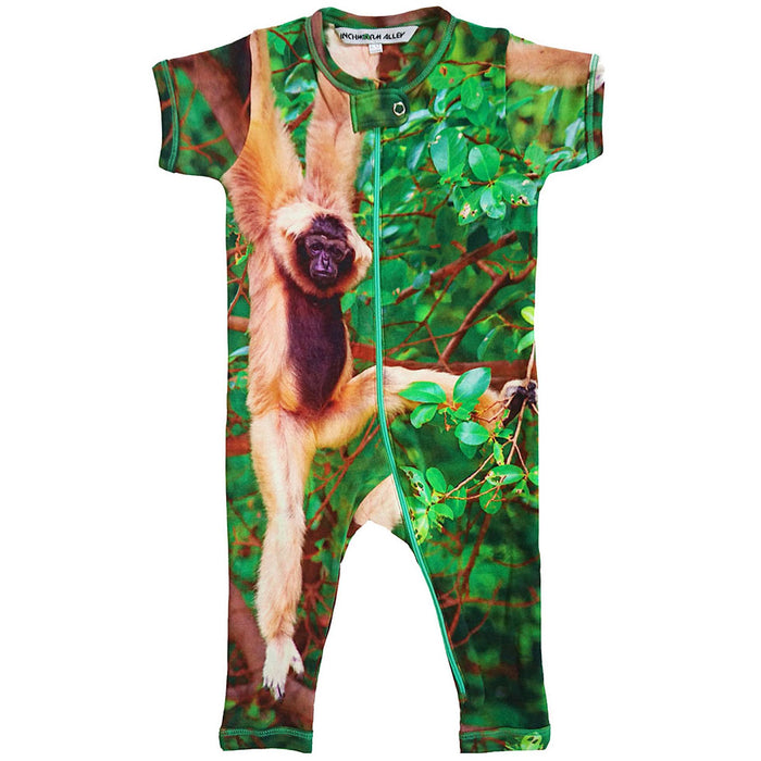 Front view of short sleeve romper with full legs printed wih a monkey hanging from a tree