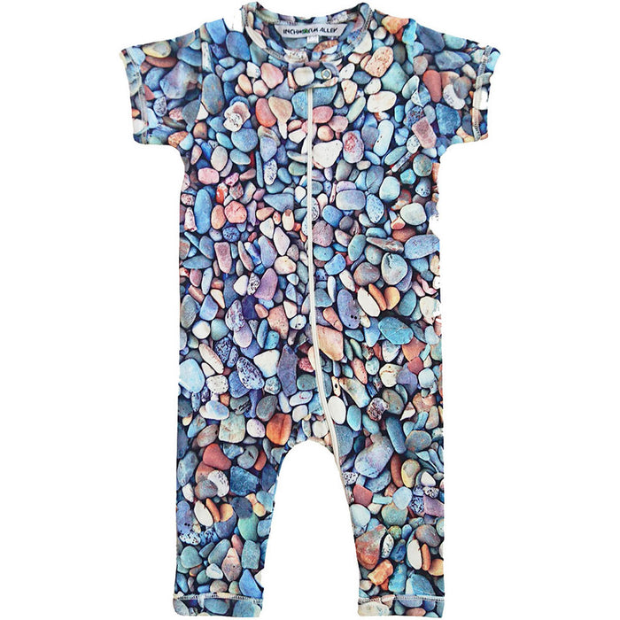 Front view of short sleeve romper with all-over print of pebbles and stones