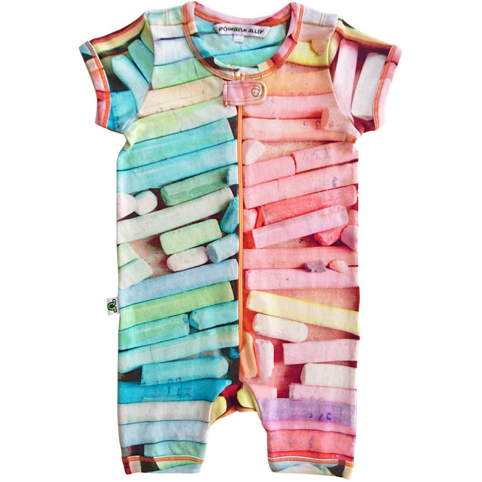 Short sleeve romper with a large-scale print of a pastel or chalk box filled with different pastel colours
