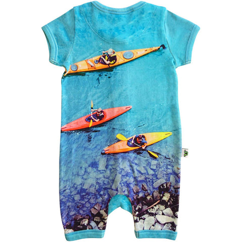Short sleeve romper with a print of three people canoeing or kayaking down a blue river with rocks and pebbles
