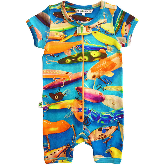 Short sleeve romper with an overall print of colorful fishing lures and hooks against a blue backdrop