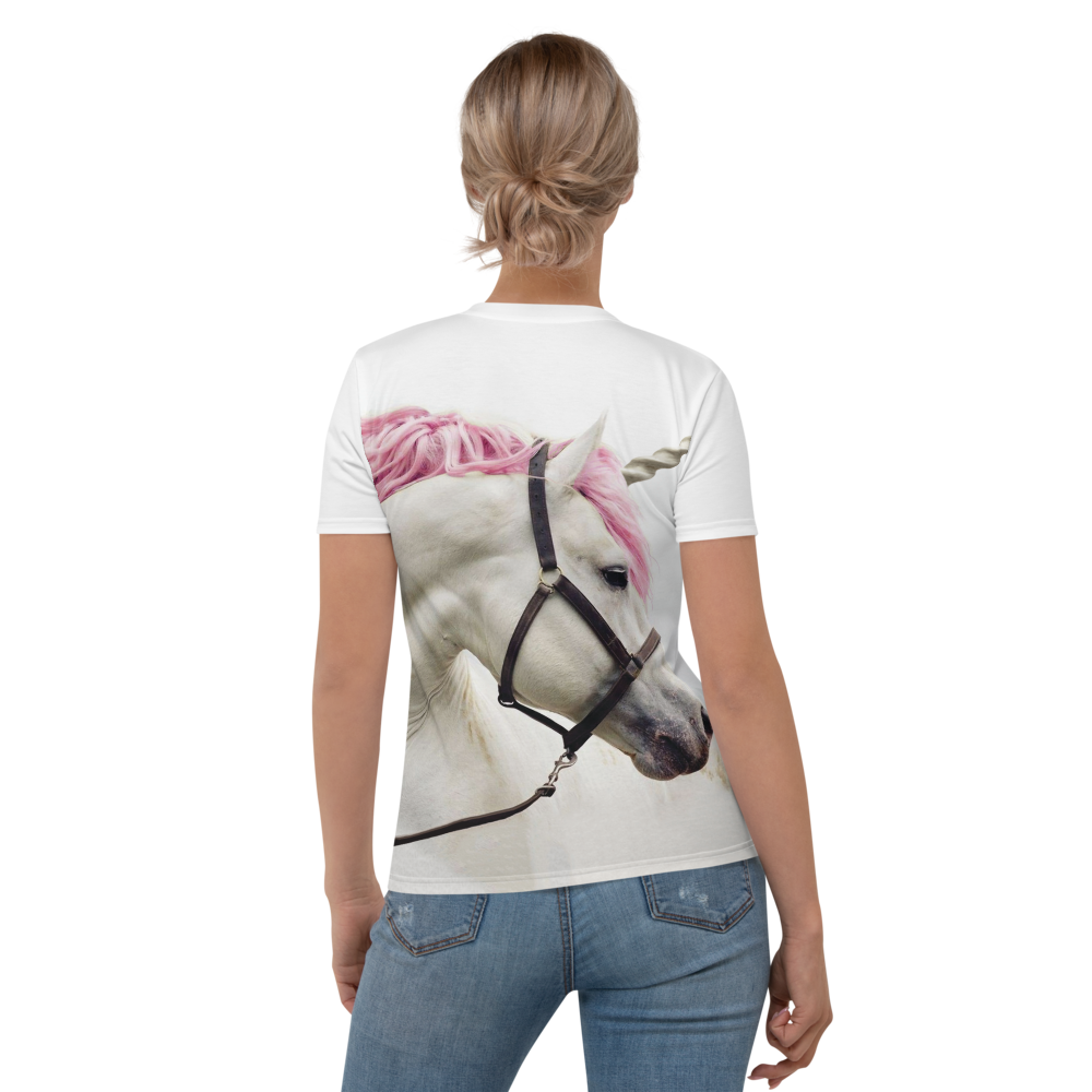 Woman wearing a tee with an image of a white unicorn with a hot pink mane