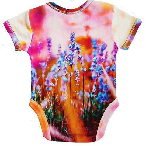 Back view of a short sleeve bodysuit printed with an image of lavender in bloom