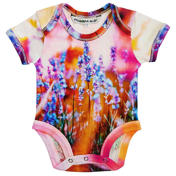 Front view of a short sleeve bodysuit printed with an image of lavender in bloom