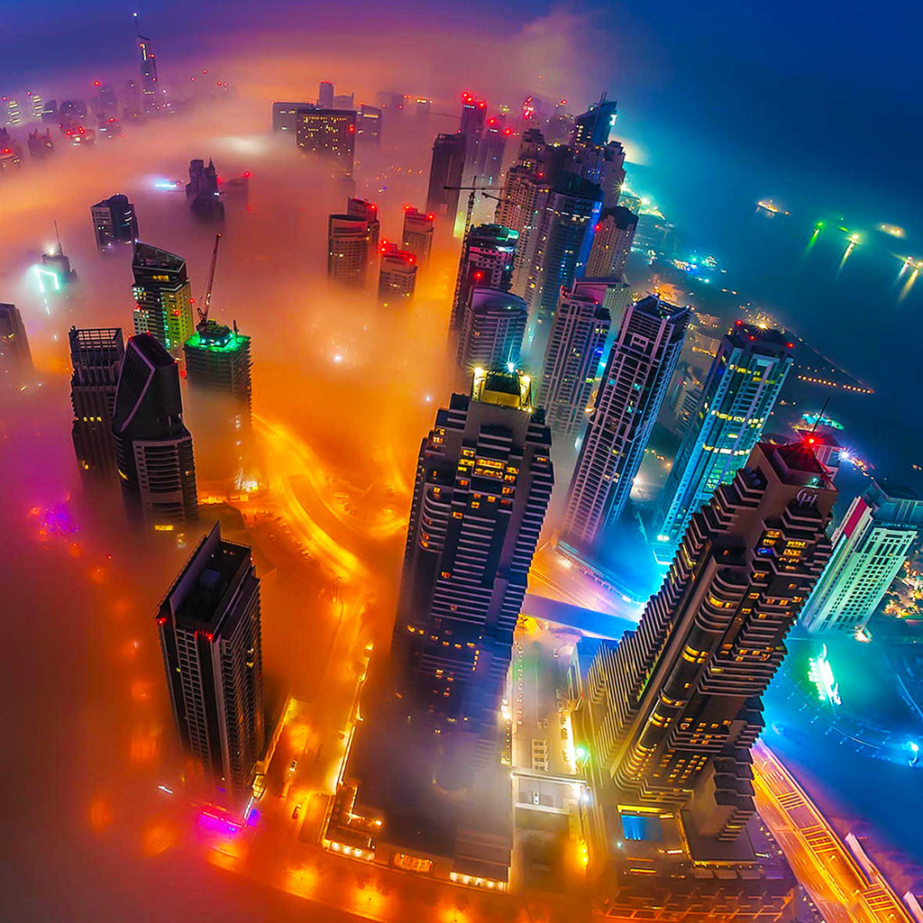 Image of skyscrapers and city lights glowing through the fog settling over Dubai