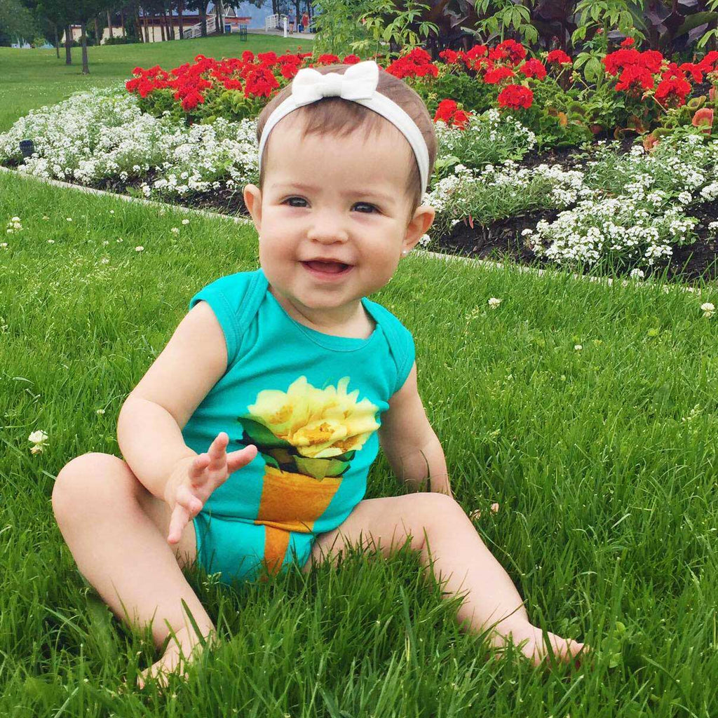 Baby wearing a tank bodysuit with flowers in an ice cream cone