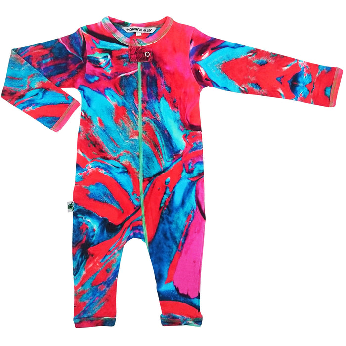 Long sleeve, full leg romper onesie with a print of teal, red and fuschia paintbrush strokes
