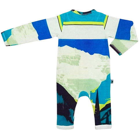 Long sleeve, full leg romper onesie printed with vintage tourism poster promoting Lake Louise and the Canadian Rockies with an illustrated mountain landscape