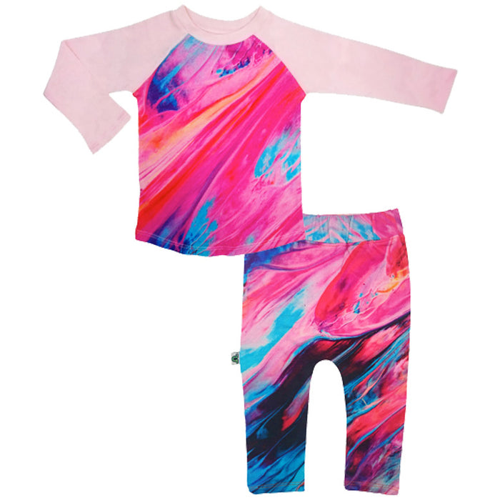 Raglan top and jogger bottom set printed with an image of bright fuchsia paintbrush strokes dotted with blue and black