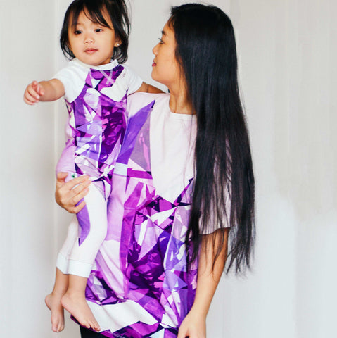 Mother and daughter wearing outfits with matching amethyst crystal print