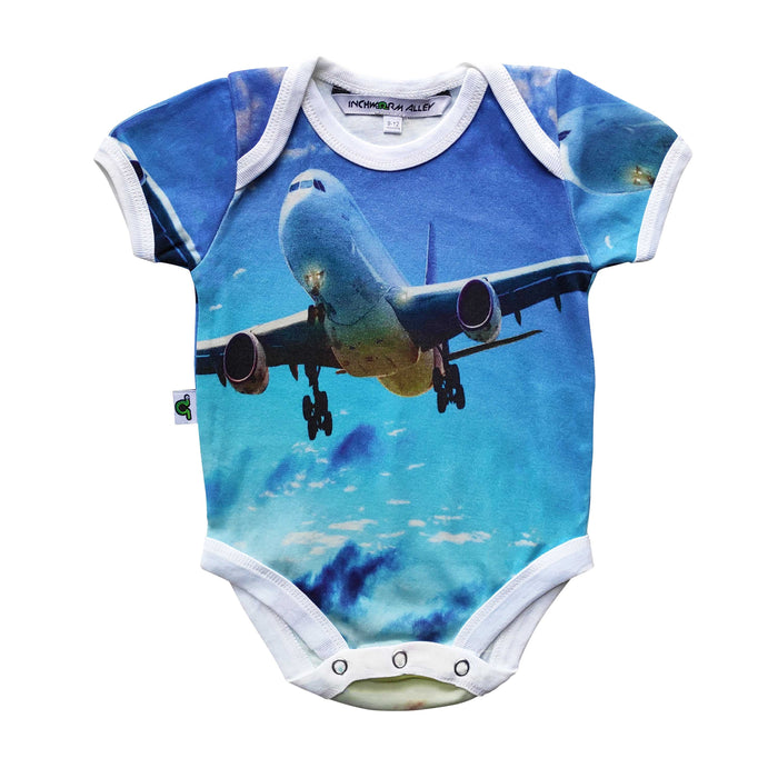 Short sleeve bodysuit onesie printed with an airplane flying against a blue sky