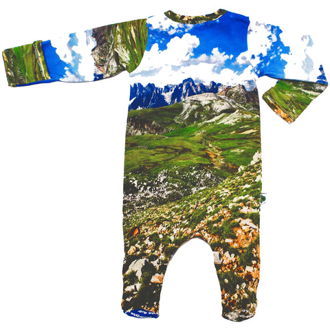 Back view of a long sleeve footie with a landscape image of the Alps