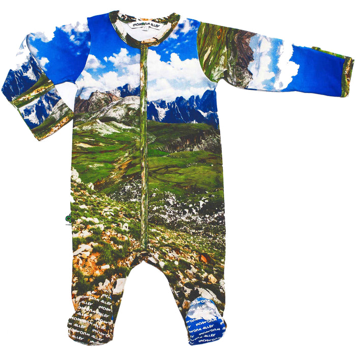 Front view of a long sleeve footie with a landscape image of the Alps