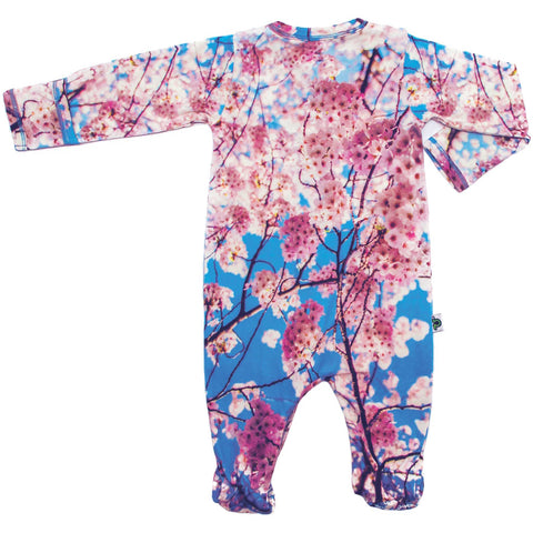 Back view of a long sleeve footie with an all-over print of cherry blossoms