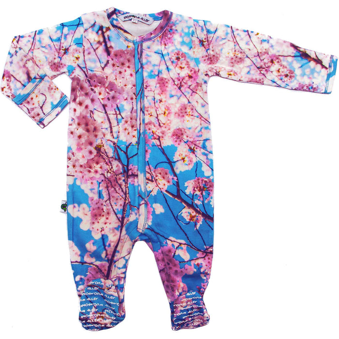 Front view of a long sleeve footie with an all-over print of cherry blossoms