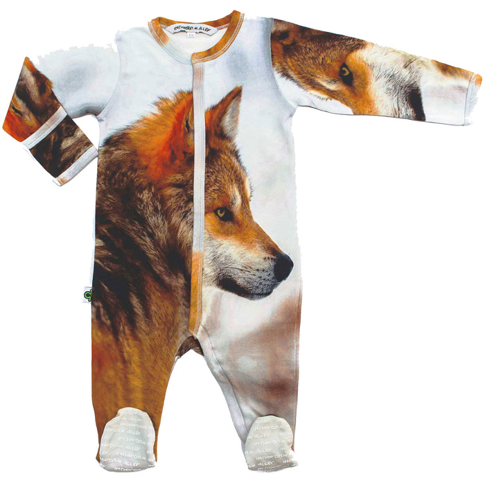 Front view of long sleeve footie printed with a side profile of a wolf