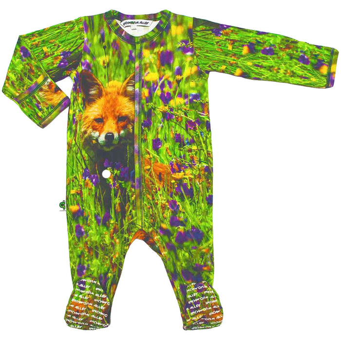 Front view of long sleeve footie with a young fox in a valley of wildflowers