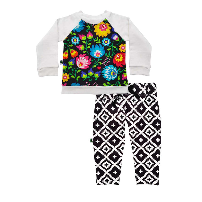 Raglan sweatshirt and French Terry joggers set with a folksy, flowery, boho print and monochromatic bottoms