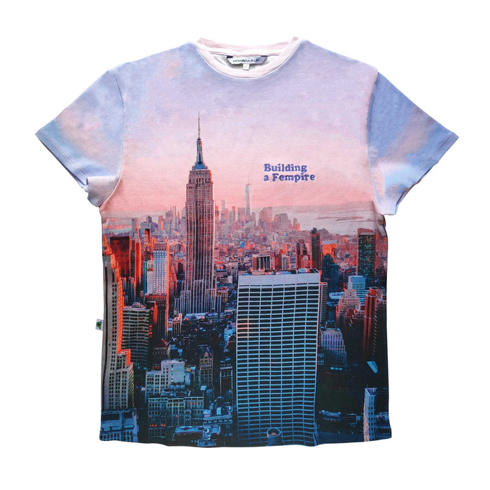 Adult tee with pink/purple pastel image of the Empire State Building and city skyline with the words Building A Fempire