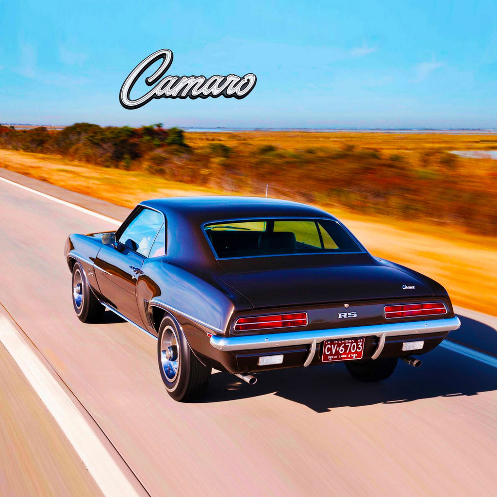 Image of a classic Camaro driving down a road and the word Camaro across the chest