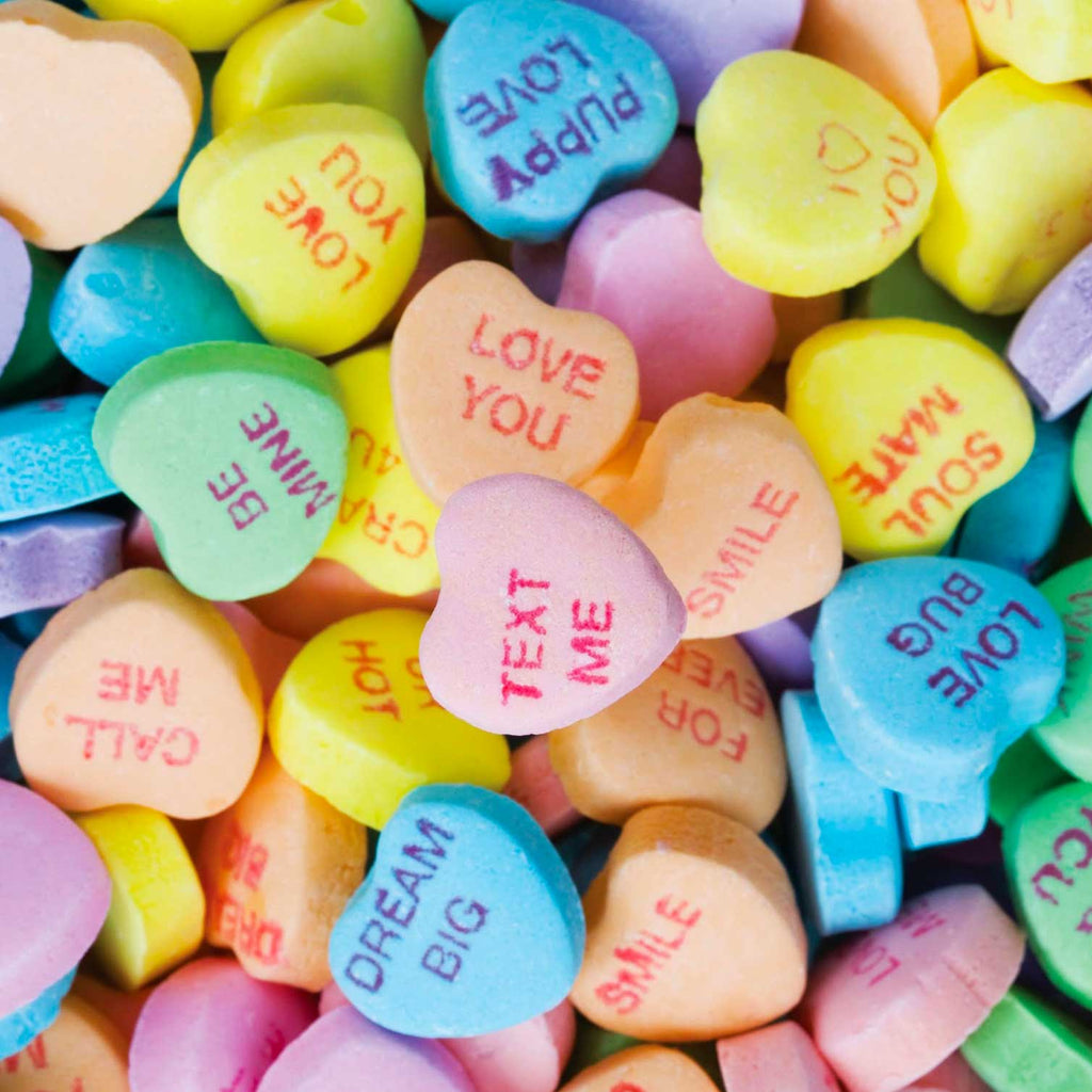 Oversized image of candy hearts imprinted with messages