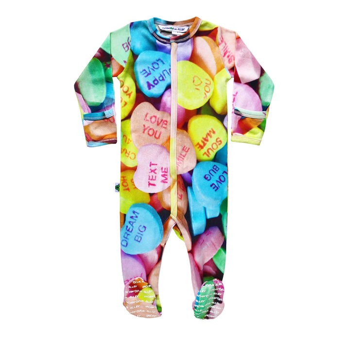 Long sleeve footie with oversized all over print of candy hearts imprinted with messages
