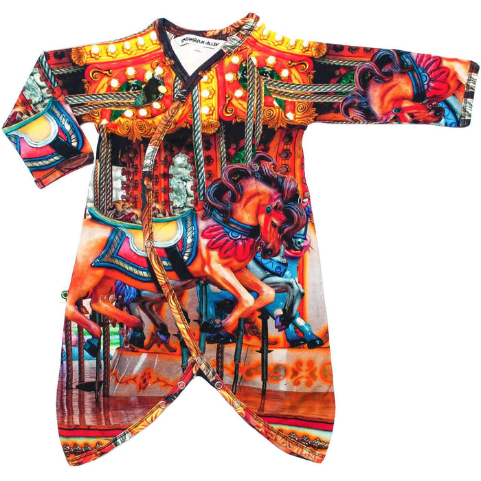 Front view of kimono wrap-front, drop-crotch romper with print of carnival carousel horses