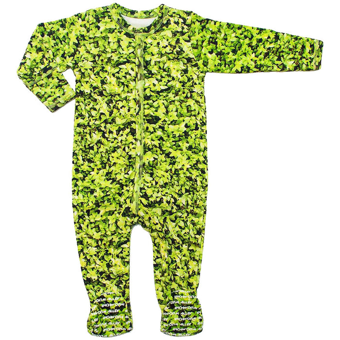 Front view of a long sleeve footie with an all-over print of green leaves