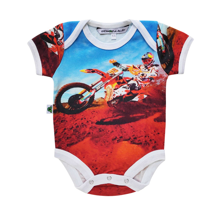 Short sleeve bodysuit onesie with action shot of a dirt biker tearing over a dirt hill against a blue sky