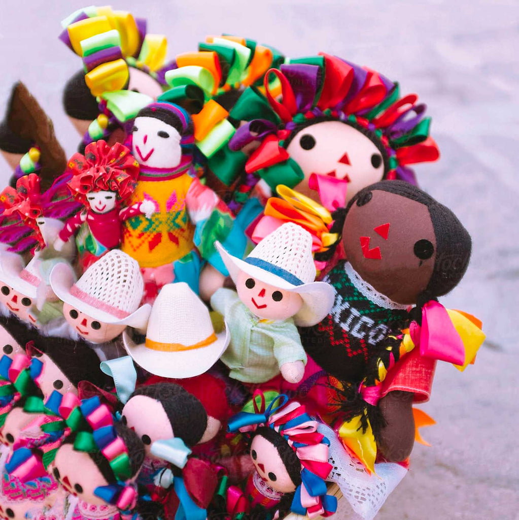 Image of basket of Mexican Marias or colourful rag dolls