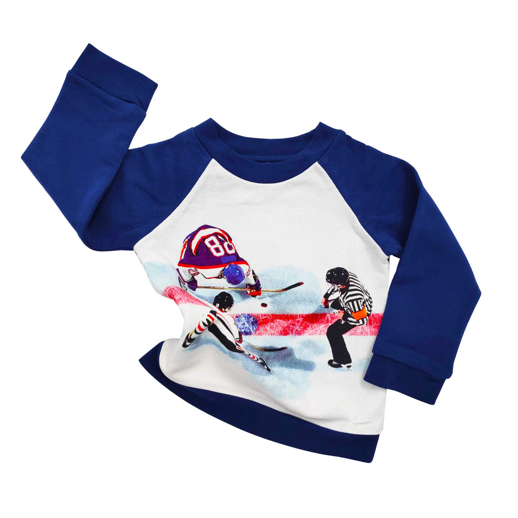 Long sleeve raglan sweatshirt printed with an overhead photo of two hockey players facing off in front of a referee