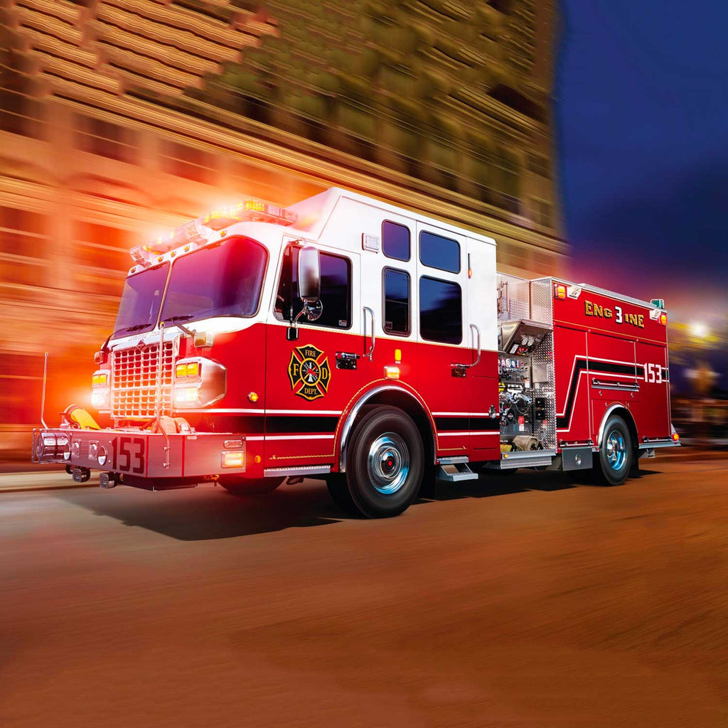Image of a bright red fire truck in motion